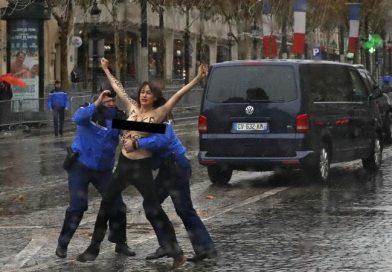 पेरिस में टॉपलेस होकर लड़की ने किया ट्रंप का विरोध, काफिले को रोकनी की कोशिश भी की, इस कार्यक्रम में भारत से उपराष्ट्रपति भी हुए थे शामिल